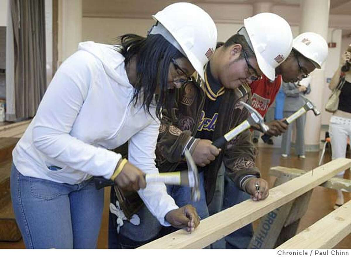 Students (L to R) Sade Richardson, Carlos Molina and Katorry Taylor tried to hammer in as many nails as they could for one minute. The Building and Trades Union gives continuation high schools in San Francisco new shop classes and vocational skills training in a time when both are being sacrificed to academic classes and standardized test preparation. Ida B. Wells High School on 9/23/04 in San Francisco, CA. PAUL CHINN/The Chronicle