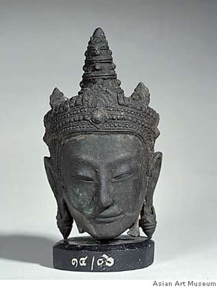 Crowned head, from a set of figures representing the Buddha in his previous lives, probably 1458  Copper alloy, Chao Sam Phraya National Museum, Ayutthaya, 14/06. From the exhibition The Kingdom of Siam: The Art of Central Thailand, 1350-1800 on view at the Asian Art Museum from February 18 through May 8, 2005. Photograph by Kaz Tsuruta. PERMISSION IS GRANTED TO REPRODUCE THIS IMAGE SOLELY IN CONNECTION WITH A REVIEW OR EDITORIAL COMMENTARY ON THE ABOVE-SPECIFIED EXHIBITION. ALL OTHER REPRODUCTIONS ARE STRICTLY PROHIBITED WITHOUT THE PRIOR WRITTEN CONSENT OF THE ARTIST AND/OR MUSEUM.