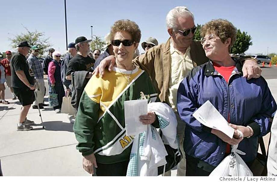 (left to right) Ruth Glantez with her brother inlaw and sister Harold and Mirian Rasmussen discuss the steroid scandal as they stand inline for the Oakland A's and Seattle Mariners game in Peoria, March 15, 2005. Fans at the Cactus League games beginning Tuesday about what they think of the congressional hearings into Major League Baseball players' steroid use and the league's testing plans. Fans at the Oakland A's game against Seattle Mariners, in Peoria Arizona, MArch 15, 2005. Photographer Lacy Atkins Photo: LACY ATKINS