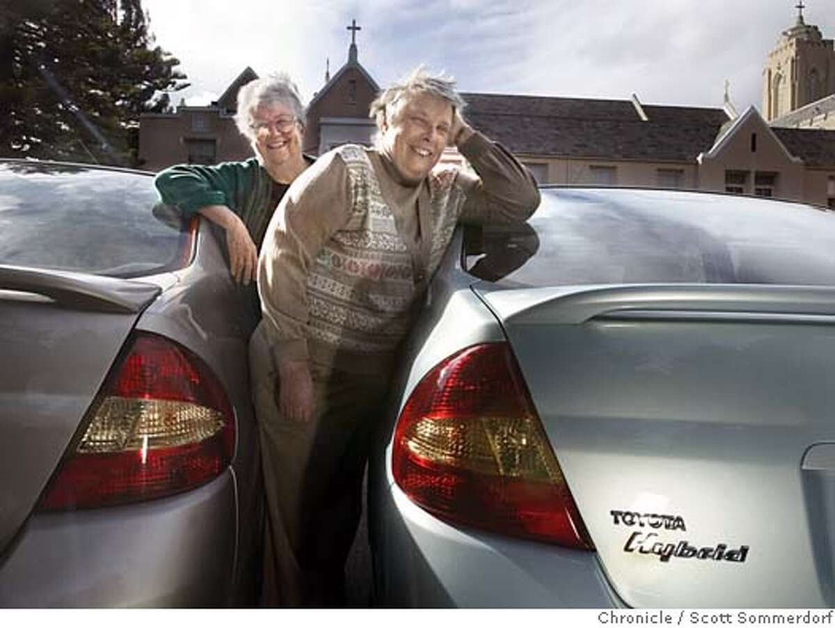 The Sisters of Mercy in Burlingame have eight Toyota Prius hybrid cars and two more staff members on campus own two more. Sisters Patricia Ryan (left), and Charleen Koenig (all cq) proudly pose with their cars in front of the convent. SCOTT SOMMERDORF / The Chronicle