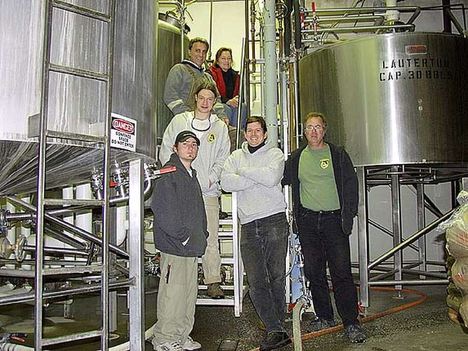 Lagunitas' gang: Brewer Fadi Maloof (top, left) and Operations Manager Carissa Brader (top, right), Jeremy Irons (center), and Coley Thinnes, Ben Grossman and founder Tony Magee (from left).