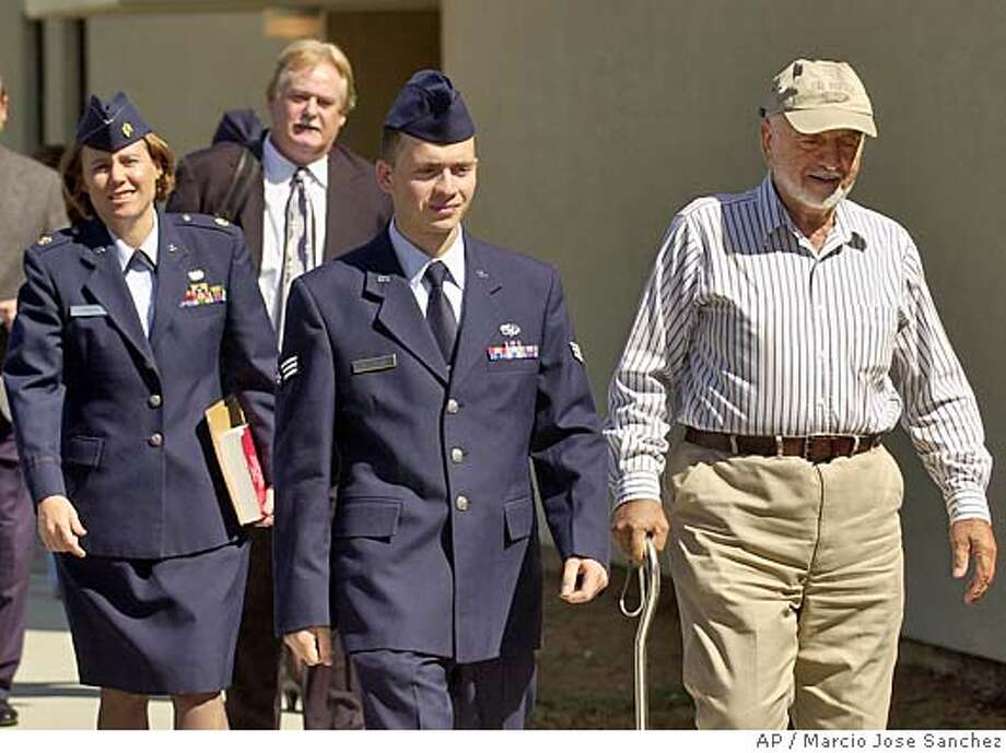 Senior Airman Ahmad Al Halabi , middle, walks out of court for a lunch break with his father Ibrahim, right, and members of his defense team in Travis Air Force Base, Calif., on Thursday, Sept. 23, 2004. Al Halabi is due to be sentenced Thursday on espionage charges over accusations that he was spying at the base holding terror detainees at Guantanamo Bay, Cuba. (AP Photo/Marcio Jose Sanchez) Nation#MainNews#Chronicle#9/24/2004#ALL#5star##0422370011 Photo: MARCIO JOSE SANCHEZ