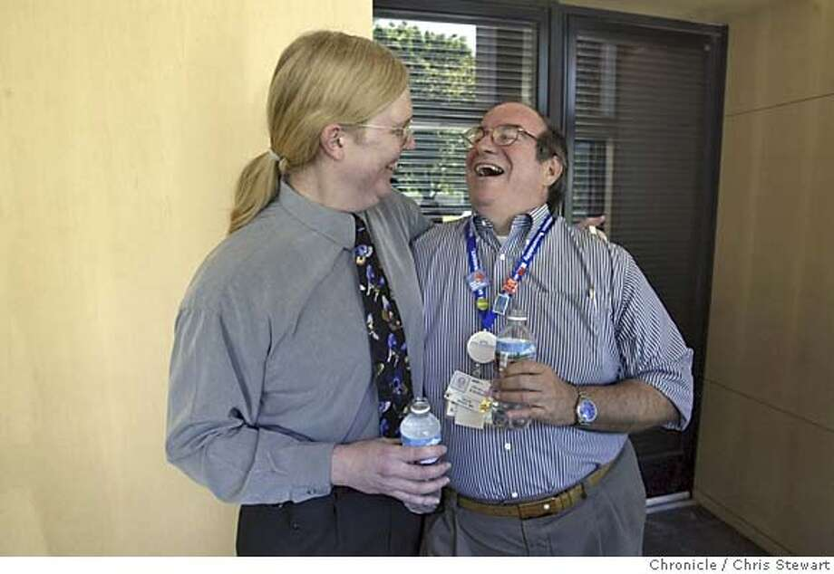 transgenderdoc143.jpg Event on 3/15/05 in Walnut Creek.  Dr. Judson Lively shares a laugh with Dr. David Niver at the Shadelands Art Center in Walnut Creek where Lively, Kaiser�s top doctor for Contra Costa and parts of Alameda County, told her staff Tuesday to call her by a new name: Judy. The 48-year-old surgeon and administrator has known since fourth grade that she was a girl trapped in a boy�s body. Lively will finally put aside the stereotypical male persona she has worked to create over the years � Army surgeon, skydiver, martial arts expert � and be her real self. She has been taking hormones for three years (but bound her breasts for work), grown her hair and nails and has been living as a woman outside of work, with the support of her wife and adult daughter. After Tuesday�s announcement and another meeting, Lively will take 10 days off, legally change her name, and return to her job wearing scarves instead of ties. She plans to continue seeing patients once her medical license and prescription pads catch up with her new name and gender. An inside look at how someone with a very public identity as a man tells the world that she identifies as a woman. Chris Stewart / The Chronicle MANDATORY CREDIT FOR PHOTOG AND SF CHRONICLE/ -MAGS OUT Photo: Chris Stewart