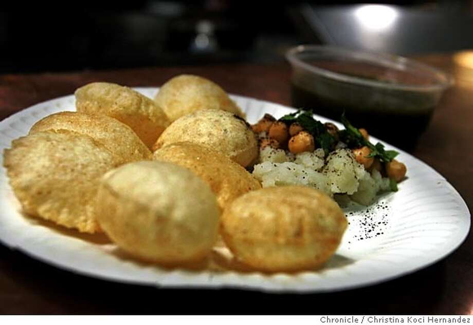 chaat16022_ckh.jpg This is Pani Puri.This is for a roundup of chaat places. This one is for Vik's in Berkeley, one of the more popular places. not that pretty on the inside, but during the weekends, plenty of families, local color, etc. Try to shoot the food--can't go wrong shooting masala dosa, pani puri or cholle bhatura. .CHRISTINA KOCI HERNANDEZ/CHRONICLE Photo: CHRISTINA KOCI HERNANDEZ