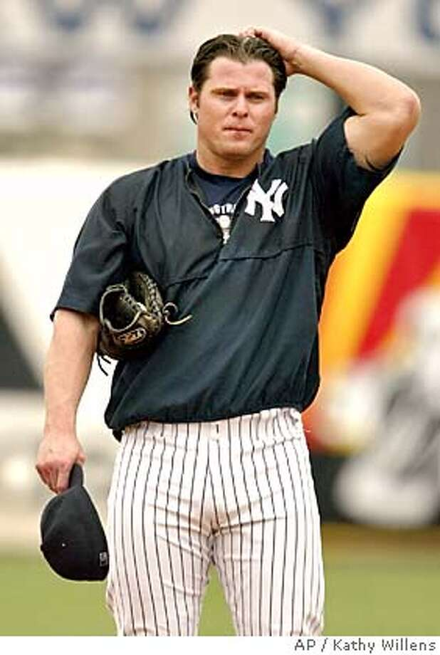 New York Yankees designated hitter Jason Giambi scratches his head during pregame warmups before the Yankees game against the Florida Marlins, Tuesday, March 15, 2005, at Legends Field in Tampa, Fla. Giambi may find out Tuesday whether he will have to testify about steroid usage at Thursday's congressional hearings in Washington D.C. (AP Photo/Kathy Willens) Photo: KATHY WILLENS