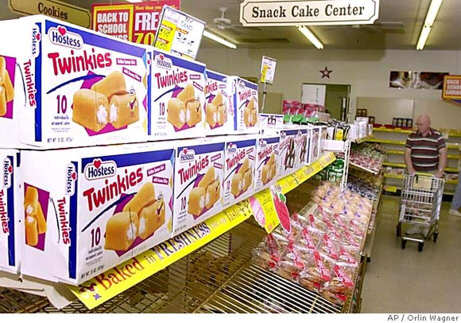 ** FILE ** Twinkies await sale on a shelf in a Wonder Bread Outlet store Tuesday, Aug. 19, 2003, in Lawrence, Kan. Interstate Bakeries Corp., the nation's largest wholesaler baker whose products include Twinkies and Wonder Bread, filed for Chapter 11 bankruptcy protection early Wednesday, Sept. 22, 2004. (AP Photo/Orlin Wagner) AUG. 19, 2003, PHOTO Business#Business#Chronicle#9/23/2004##5star##0422367168 Photo: ORLIN WAGNER