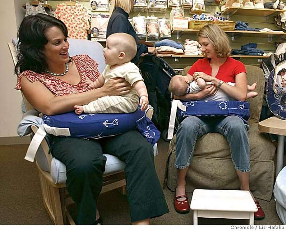 Andrew Zenoff designed a pillow for breast feeding women. At left is Ceres Rutan and her daughter Lucia Rutan, 6 mos. old, and at right is Virginia Peterson and her son Tucker Peterson, 7 mos. old with these pillows. Shot on 9/21/04 in San Francisco. LIZ HAFALIA / The Chronicle Photo: LIZ HAFALIA