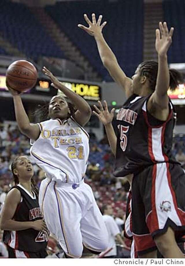arco_251_pc.jpg  Oakland Tech's Alexis Gray-Lawson goes up for two points over Fairfield's Sekayi Khalid in the fourth quarter. Oakland Tech Bulldogs vs. Fairfield Falcons in Girls Division I finals of the Northern California Regional High School Basketball Championships at ARCO Arena on 3/12/05 in Sacramento, CA.  PAUL CHINN/The Chronicle MANDATORY CREDIT FOR PHOTOG AND S.F. CHRONICLE/ - MAGS OUT Photo: PAUL CHINN
