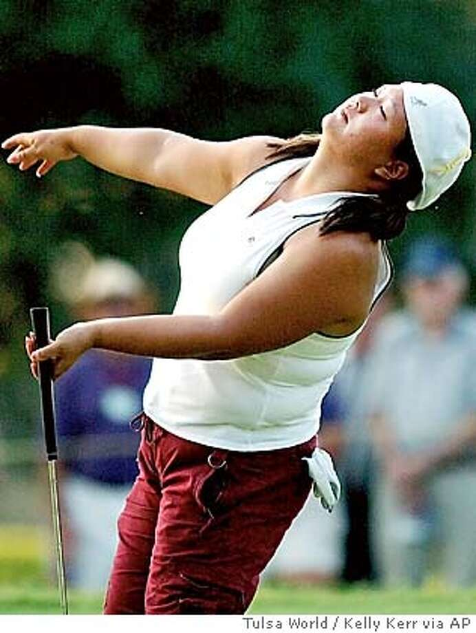 Christina Kim reacts to missing a birdie putt on No. 18 at Cedar Ridge Country Club in Broken Arrow, Okla., during the second round of the John Q. Hammons Hotel Classic LPGA tournament Saturday, Sept. 11, 2004. (AP Photo/Tulsa World, Kelly Kerr) Sports#Sports#Chronicle#9/23/2004#ALL#5star##0422342452 Photo: KELLY KERR