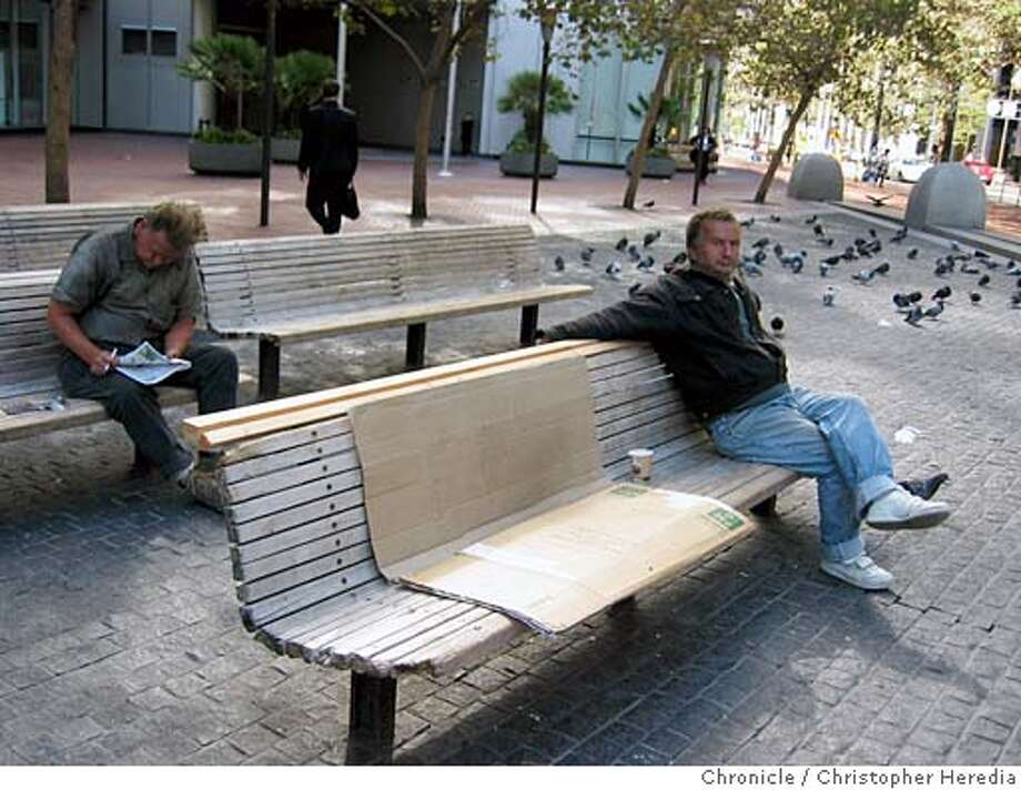 cwbenches01.JPG FOR CHRONWATCH USE ONLY ChronicleWatch looks at dilapidated benches at public plaza at Market and Battery streets. In this series of photos, benches have been fitted with temporary wooden slats. 9/20/04 in San Francisco, CA. Christopher Heredia / The Chronicle Photo: Christopher Heredia