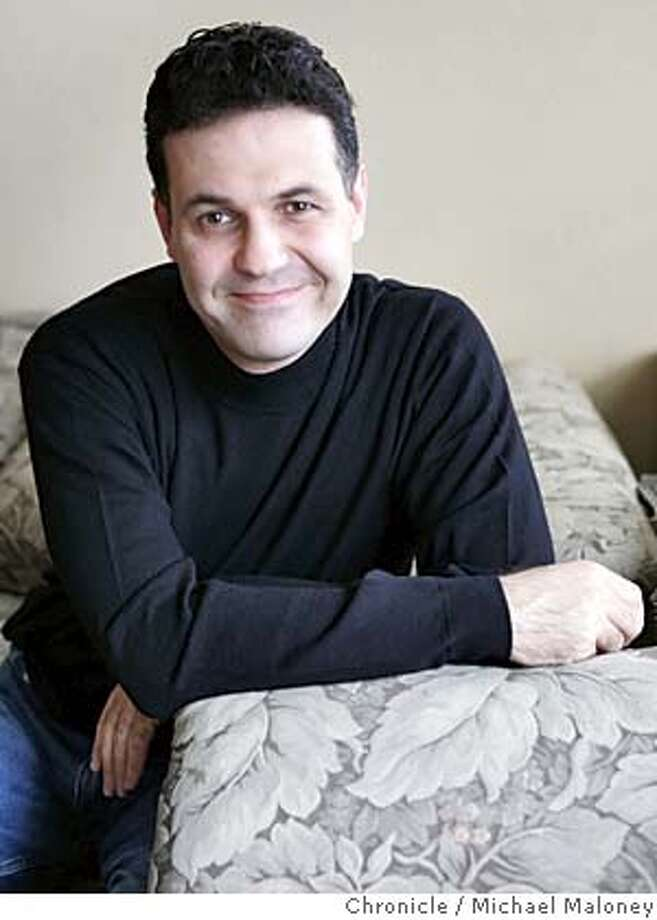 "South Bay novelist Khaled Hosseini is riding a huge wave of success with his best-selling novel, ""The Kite Runner."" A tale of two young boys in Afghanistan prior to the Soviet invasion, the book has slowly and steadily crept up the best-seller lists since it was released as a trade paperback last year. It�s now #1 in the Bay Area, #2 nationwide. Hosseini, 39, was born in Afghanistan, came to the U.S. as a teenager and became a doctor. He wrote this novel, his first, while practicing medicine full-time and raising two children. Photo by Michael Maloney / San Francisco Chronicle MANDATORY CREDIT FOR PHOTOG AND SF CHRONICLE/ -MAGS OUT Photo: Michael Maloney"