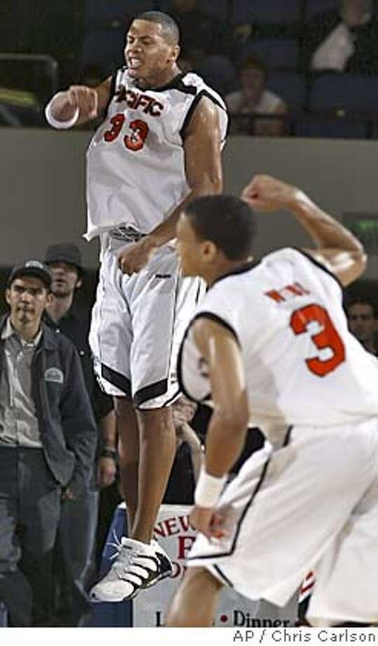 Pacific'sGuillaume Yango reacts to one of his baskets as Mike Webb looks on in their 63-61 win over Cal State Northridge'in the Big West men's basketball tournament game in Anaheim, Calif., on Friday, March 11, 2005. (AP Photo/Chris Carlson) Photo: CHRIS CARLSON