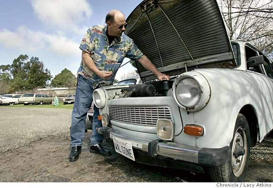 Rodney Dahlgren checks the oil of his Trabant with the plastic oil stick that comes with the car at his home in Napa, Wed. Feb23,2005. story is about people who own offbeat -- very offbeat -- cars, sometimes called awful cars because they were awful, otherwise just rare cars that no one bought. wednesday's example will be a Trabant owned by Rod Dahlgren, in Napa Feb.23,2005. Photographer Lacy Atkins / San Francisco Chronicle Photo: LACY ATKINS