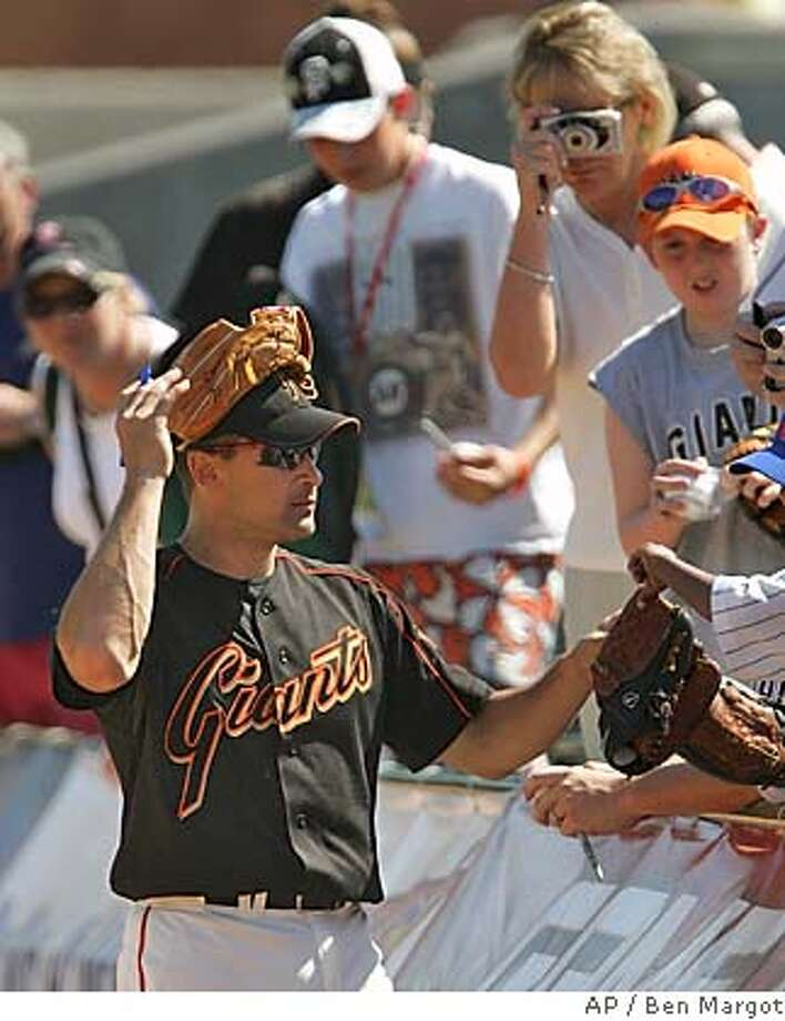 San Francisco Giants' Omar Vizquel signs autographs for fans prior to the spring training game with the Kansas City Royals Sunday, March 13, 2005, in Scottsdale, Ariz. (AP Photo/Ben Margot) Photo: BEN MARGOT