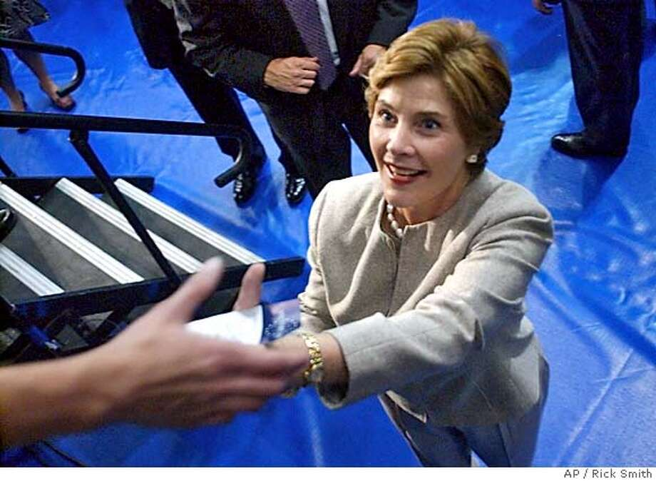 First lady Laura Bush greets a supporter during a campaign rally at East Stroudsburg University, in East Stroudsburg, Pa., Friday, Sept. 17, 2004. (AP photo/Rick Smith) Photo: RICK SMITH