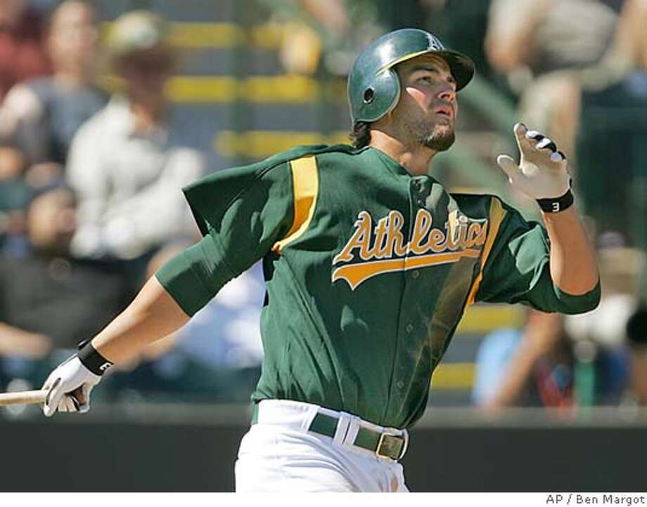 Oakland Athletics' Eric Chavez follows through after hitting a three-run home run off Chicago White Sox' Jose Contreras in the third inning of a spring training game Saturday, March 12, 2005, in Phoenix. (AP Photo/Ben Margot) Photo: BEN MARGOT