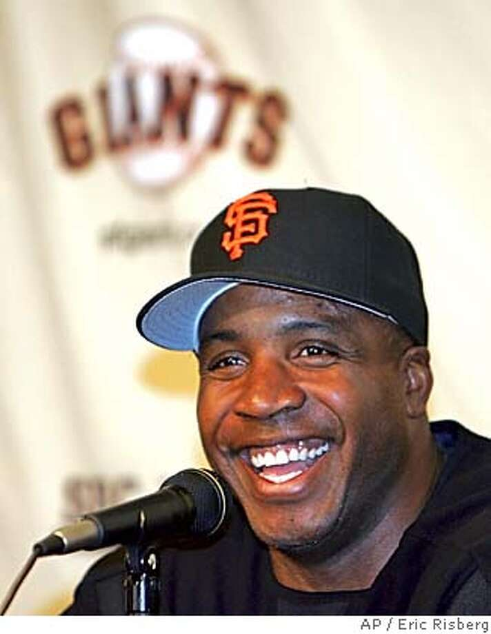 San Francisco Giants' Barry Bonds smiles during a news conference at SBC Park after the Giants' announced that Bonds will be with the club through the 2006 season, in San Francisco, Tuesday Sept. 21, 2004.(AP Photo/Eric Risberg) Photo: ERIC RISBERG