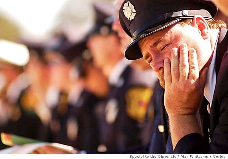 Livermore-Pleasanton Fire Engineer Pierre Rodriguez grieves at Eva Schicke's memorial services in Angels Camp, Monday September, 20, 2004. (Photo by Max Whittaker/Corbis) Special to the Chronicle Photo: Max Whittaker