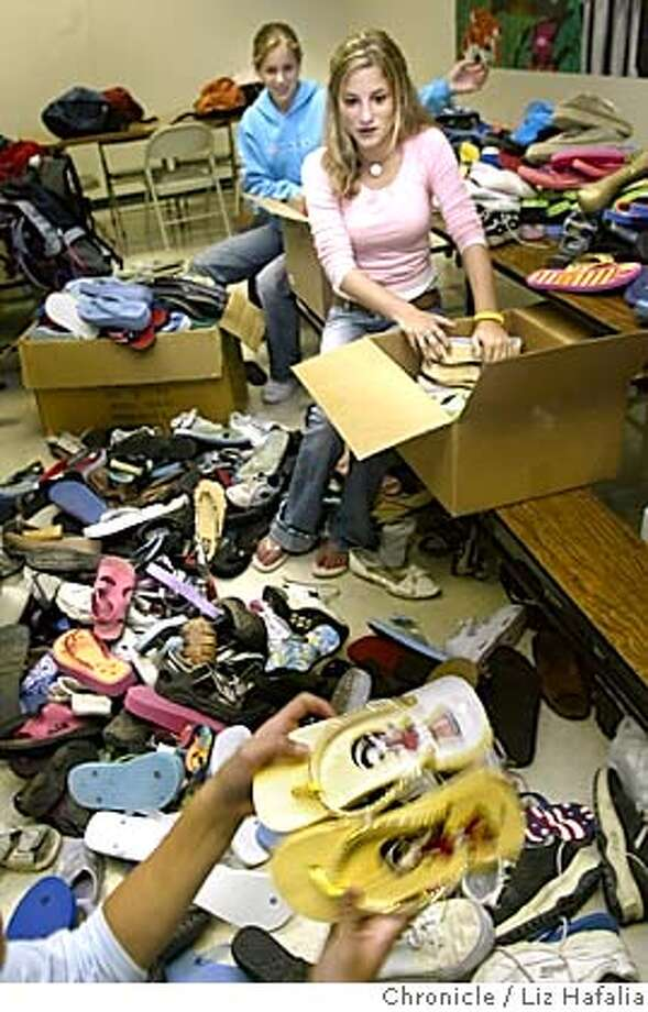 Charlotte Wood Middle School has collected roughly 500 pairs of flipflops for children in Iraq, where it is 137 degrees and the sand burns their feet. From back to front is Katie Barry, 13 years old (8th grader), Amanda Glass, 13 years old (8th grader), and Erica Brown, 12 years old (7th grader) sorting and packing. Shot on 9/20/04 in Danville. LIZ HAFALIA / The Chronicle Photo: LIZ HAFALIA