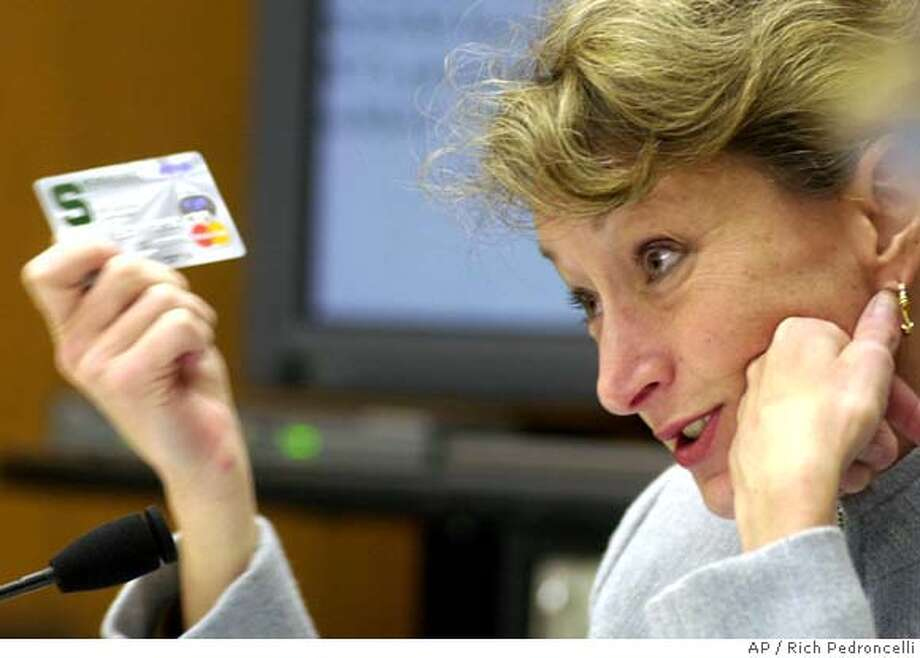 State Sen. Debra Bowen, D-Marina del Ray, holds up a credit card she received through a college alumni origanization, during a joint hearing of the Senate insurance and privacy committees held at the Capitol in Sacramento, Calif., Wednesday, Nov. 28, 2001. The committees were looking into how consumers financial, medical and birth information is sold and shared in the market place. College alumni associations and other groups often sell personal information about their members. (AP Photo/Rich Pedroncelli) DIGITAL IMAGE Photo: RICH PEDRONCELLI