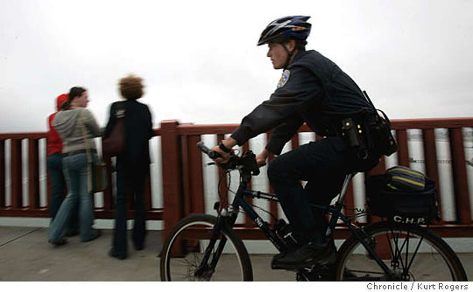 CHP officer Ross Ingels patrols the Golden Gate Bridge on bike looking for things that don't look normal to him .sometimes they even talk people from jumping off. 3/12/05 in San Francisco,CA.  KURT ROGERS/THE CHRONICLE Photo: KURT ROGERS