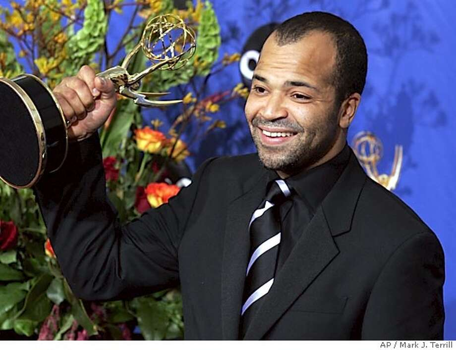 """Jeffrey Wright holds the award for outstanding supporting actor in a miniseries or a movie for his work on """"Angels In America"""" at the 56th Annual Primetime Emmy Awards Sunday, Sept. 19, 2004, at the Shrine Auditorium in Los Angeles. (AP Photo/Mark J. Terrill) Photo: MARK J TERRILL"""