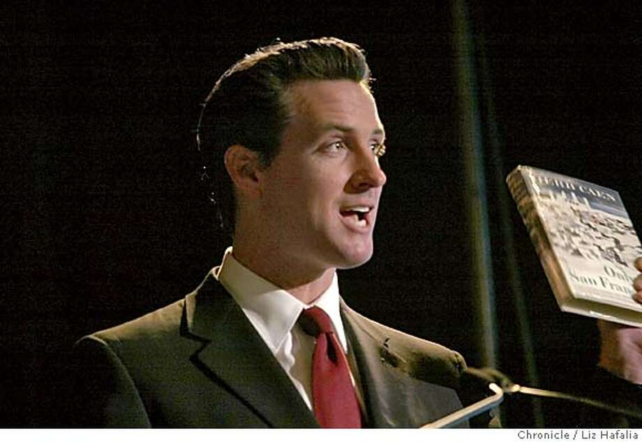 """Mayor Gavin Newsom reads excerpts from Herb Caen's book """"Only in San Francisco"""". The San Francisco Convention & Visitors Bureau (SFCVB) has launched a new branding campaign titled """"Only in San Francisco"""". Shot on 6/22/04 in San Francisco. LIZ HAFALIA / The Chronicle Photo: LIZ HAFALIA"""