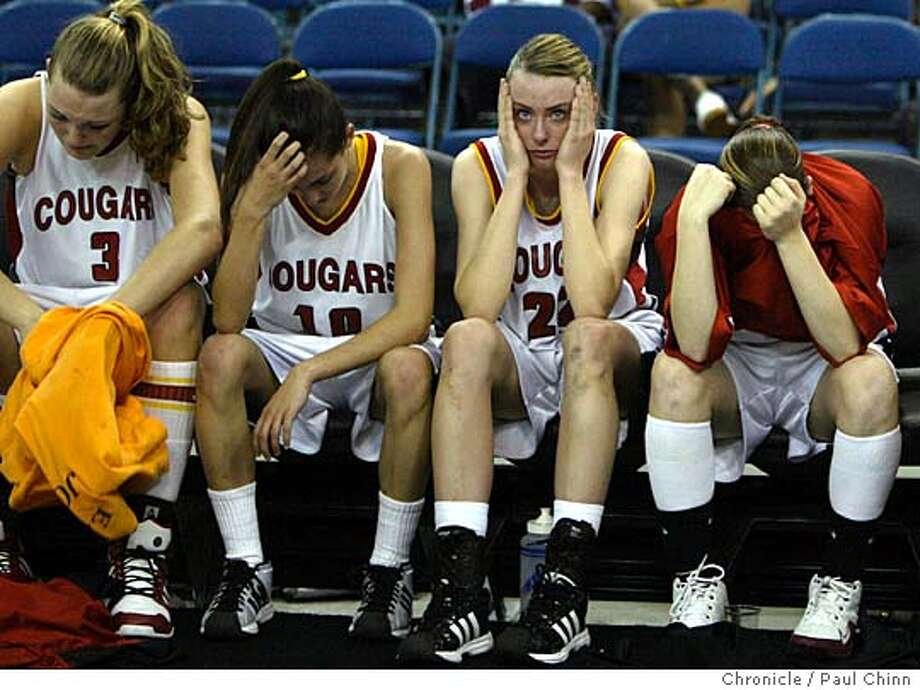 Carondelet's Jayne Appel, Alli Russi, Meighan McLafferty and Ashlee Ford absorb their stunning upset loss to Mitty. Carondelet Cougars vs. Archbishop Mitty Monarchs in Girls Division II finals of the Northern California High School Basketball Championships at ARCO Arena on 3/12/05 in Sacramento, CA.  PAUL CHINN/The Chronicle Photo: PAUL CHINN