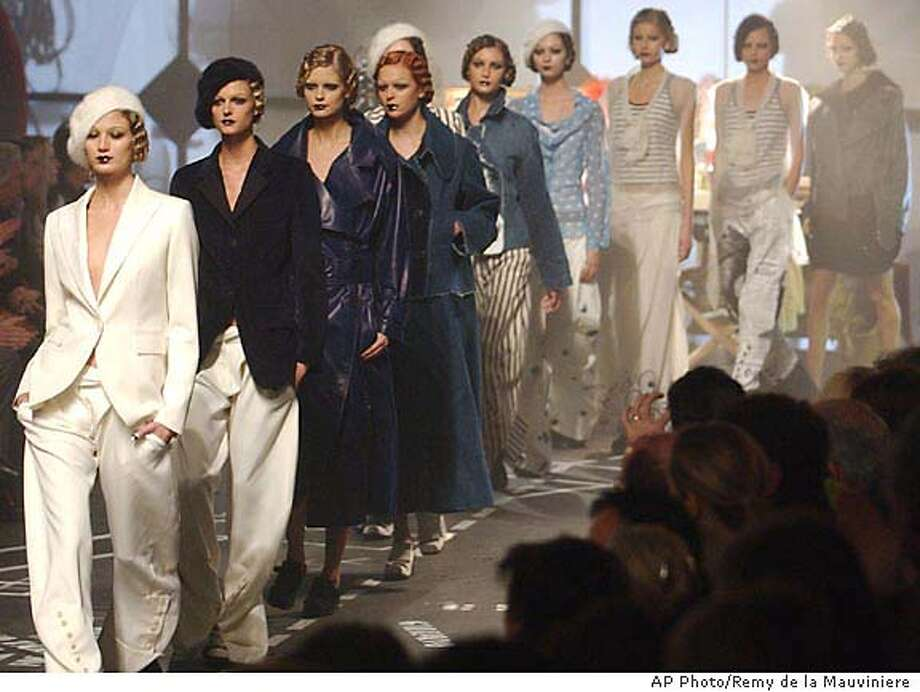 Models sport outfits by British designerJohn Galliano for his Fall-Winter 2005-2006 ready-to-wear collection, presented in Paris Saturday, March 5, 2005. (AP Photo/Remy de la Mauviniere) Photo: REMY DE LA MAUVINIERE