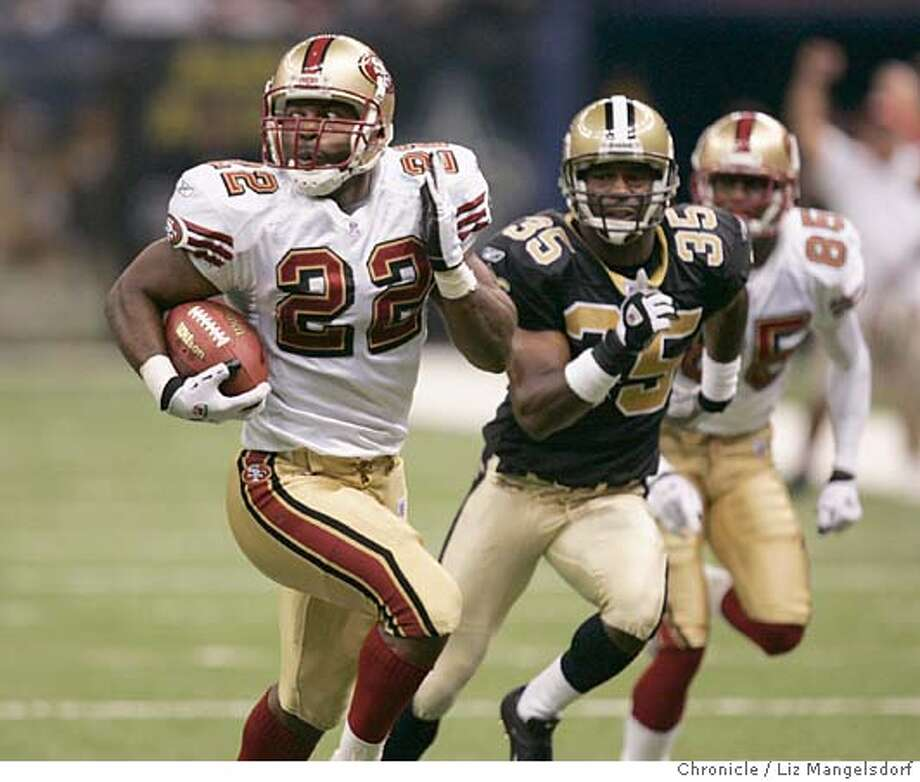 Event on 9/19/04 in New Orleans.  49er #22 Terry Jackson runs for yardage in the final seconds of the game. The play was called back because of holding by #85 Brandon Lloyd, who can be seen in the background. Saints #35 Fakhir Brown gives chase.  New Orleans Saints beat the San Francisco 49ers 30-27 at the Superdome in New Orleans.  Liz Mangelsdorf / The Chronicle Photo: Liz Mangelsdorf