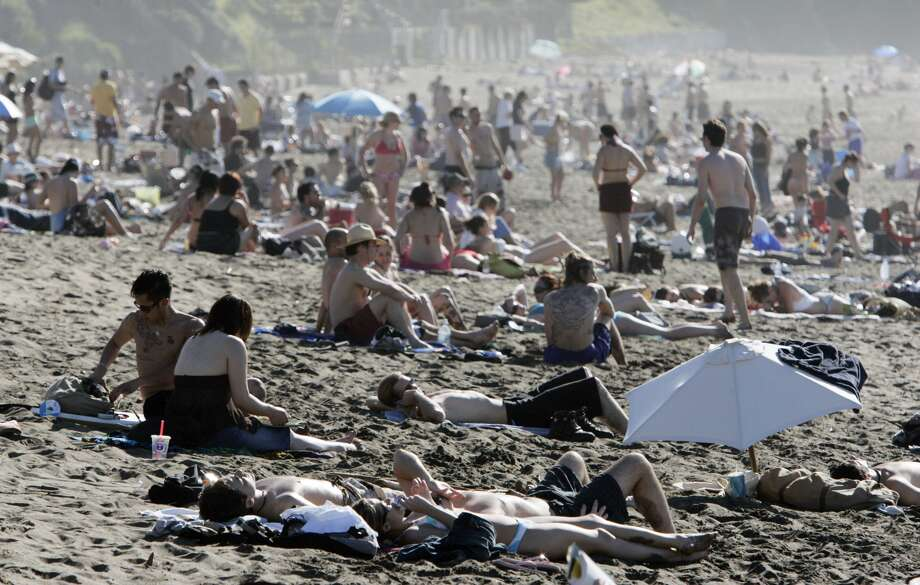 A crowded Baker Beach on a very hot day.  Weather pictures at Baker Beach, 2005. Photo: John Storey