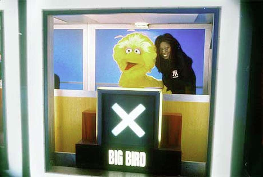 """The """"""""Hollywood Squares'' grid had to be adjusted when Big Bird (pictured with Whoopi Goldberg) guest-starred  Publicity Photo"""