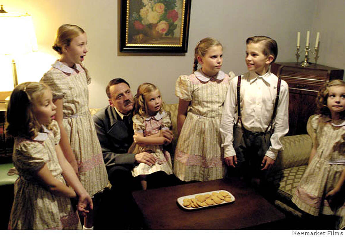 """(NYT53) UNDATED -- Feb. 16, 2005 -- Adv. for Sun., Feb. 20 -- HITLER-DOWNFALL -- Bruno Ganz as Hitler in """"Downfall,"""" with actors depicting Goebbels's children, whom their parents poisoned before taking their own lives. """"Downfall"""" is about Hitler's last 12 days in the bunker, and writer Bernd Eichinger's decision to depict the Fuehrer and his inner circle as mortals rather than monsters has set off a commotion. """"Downfall"""" stirred outrage and admiration in Germany when it opened there in September. (Newmarket Films/The New York Times)**ONLY FOR USE WITH STORY BY JULIE SALAMON SLUGGED: HITLER-DOWNFALL. ALL OTHER USE PROHIBITED. XNYZ, **ONLY FOR USE WITH STORY BY JULIE SALAMON SLUGGED: HITLER-DOWNFALL. ALL OTHER USE PROHIBITED."""