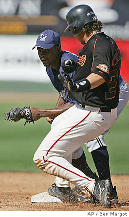 San Francisco Giants' Mike Matheny, right, steps in with a stand-up double past the tag of Milwaukee Brewers' second baseman Junior Spivey in the fifth inning of a spring training game Friday, March 11, 2005, in Scottsdale, Ariz. (AP Photo/Ben Margot) Photo: BEN MARGOT