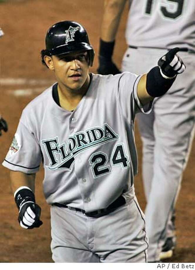 Florida Marlins' Miguel Cabrera reacts after hitting a two-run home run against the New York Mets during the sixth inning, Monday, Aug. 30, 2004 at Shea Stadium in New York. (AP Photo/Ed Betz) Photo: ED BETZ