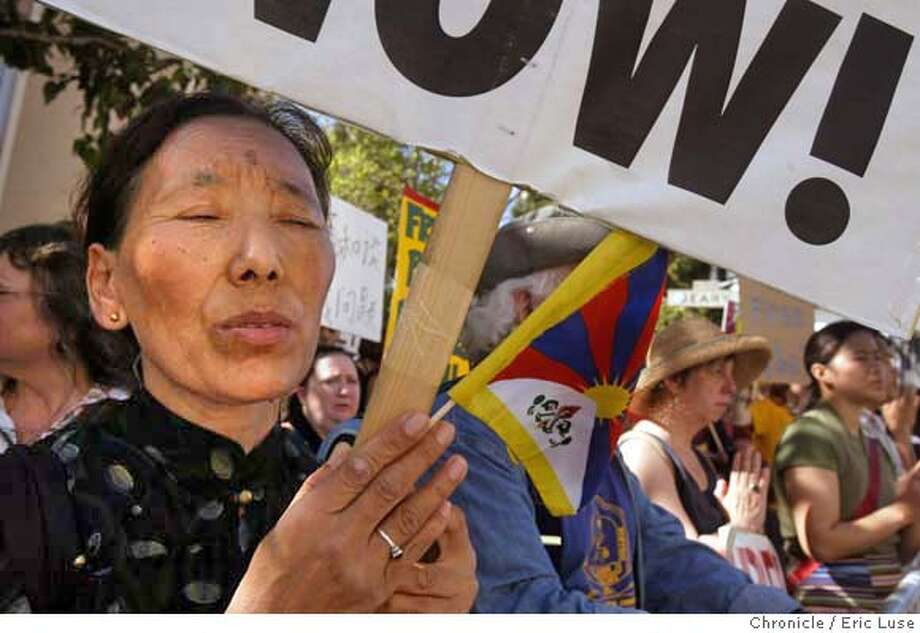 tibet11_0058_el.jpg  Sonam Chokey, Oakland, protests at the Chinese Consulate  Bay Area Tibetans will march and demonstrate in San Francisco to commemorate the 46th Anniversary of Tibetan National Uprising Day. The protestors will march from Powell/Market to City Hall before proceeding to the Chinese Consulate, where they will protest from 2-3:30 p.m. 3/10/05 in San Francisco. Eric Luse / The Chronicle MANDATORY CREDIT FOR PHOTOG AND SF CHRONICLE/ -MAGS OUT Photo: Eric Luse
