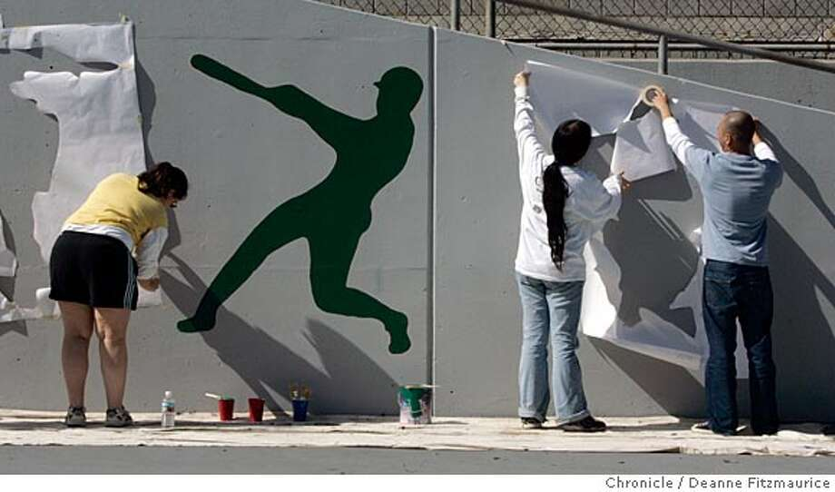 Stensils of sports figures are painted alongside the tennis courts. Volunteers came out to clean, paint, organize and plant at Hayes Valley Clubhouse and Playground.  Deanne Fitzmaurice / The Chronicle Photo: Deanne Fitzmaurice