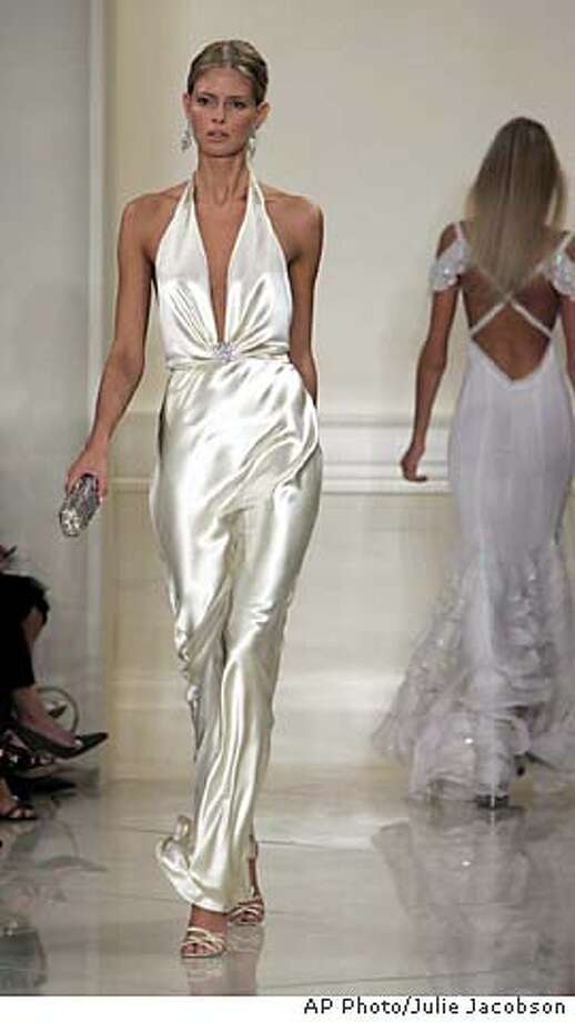 An antique ivory satin halter gown is modeled during the presentation of the spring 2005 collection of Ralph Lauren in New York Wednesday, Sept. 15, 2004. (AP Photo/Julie Jacobson) Photo: JULIE JACOBSON