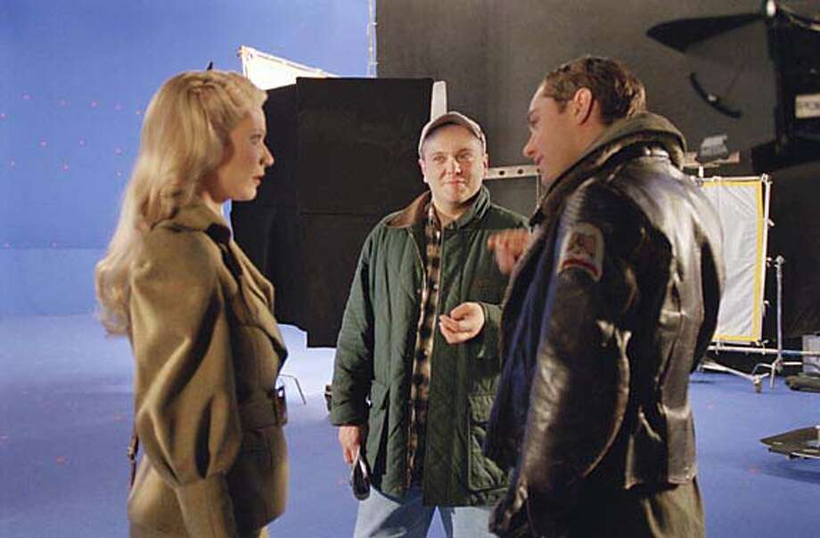 "SKY11 (Left to right) Gwyneth Paltrow, director Kerry Conran and Jude Law on the set of ""Sky Captain and the World of Tomorrow."" Keith Hamshere / Paramount Pictures"