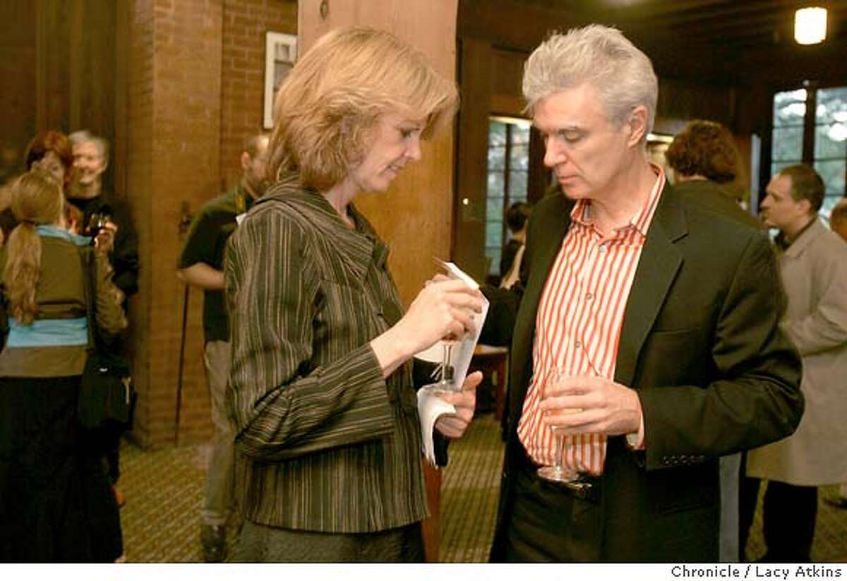 David Byrne talks with friend Darcy Lee at the reception before his lecture at UC Berkeley.subject: David Byrne, former musician with the band Talking Heads, artist, record producer etc, does a lecture at UC berkeley called