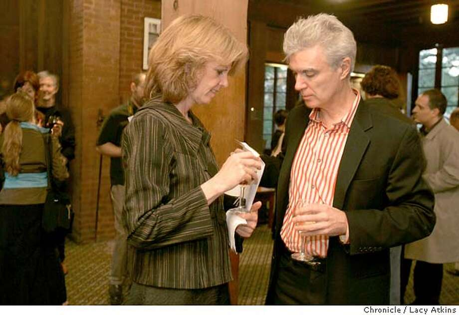 "David Byrne talks with friend Darcy Lee at the reception before his lecture at UC Berkeley.subject: David Byrne, former musician with the band Talking Heads, artist, record producer etc, does a lecture at UC berkeley called ""I [heart] PowerPoint."" Organizers say that ""PowerPoint and its attendant softwares are actually a means to a positive emotional and philosophical end, a path towards a goal that is easy to reach and available to all. The billions of people who use it are on their way to happiness, contentment and a feeling of belonging to a society that thinks and feels the same way and shares their values."" David Byrne says, ""Rather than resist, I decided that I must surrender and learn to use this software myself, for, like everyone, I long to belong. I have a long way to go: my presentations are sometimes unclear and confusing. But I have made huge advances and I feel myself more at ease with each new presentation."" MARCH 10 ,2005. Photographer Lacy Atkins Photo: LACY ATKINS"