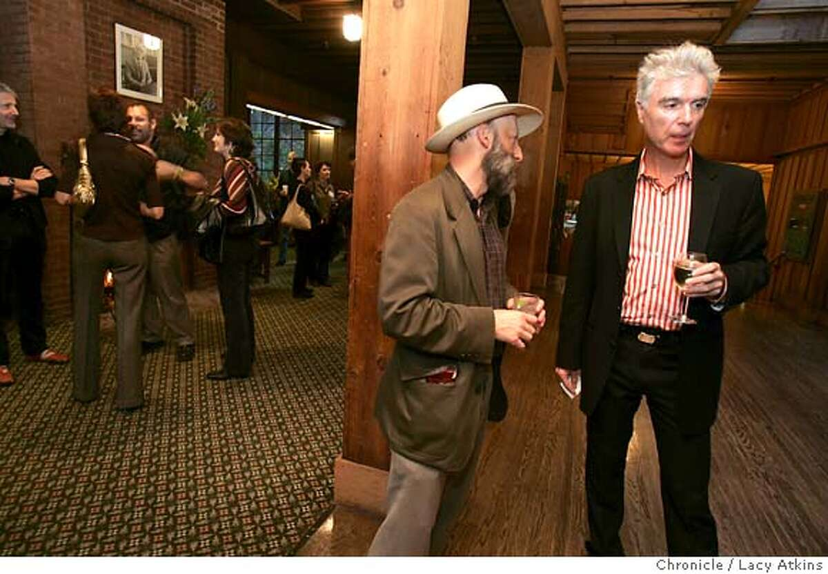 David Byrne,right talks with Peter Samis of SFMOMA at the reception before Byrne's lecture at UC Berkeley.subject: David Byrne, former musician with the band Talking Heads, artist, record producer etc, does a lecture at UC berkeley called