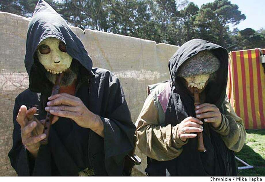 medieval190145_mk.jpg  Donnie Hodges of Berkeley and Ted Miller of San Jose are dressed as Danse (cq) Macabre, those who celebrate and ward off death.  Is it chain mail or Heavy metal. We compare the first ever Golden Gate Renaissance Faire with a Metal Fest (thats music) next weekend.  MIKE KEPKA/The Chronicle MANADATORY CREDIT FOR PHOTOG AND SF CHRONICLE/ -MAGS OUT Photo: MIKE KEPKA