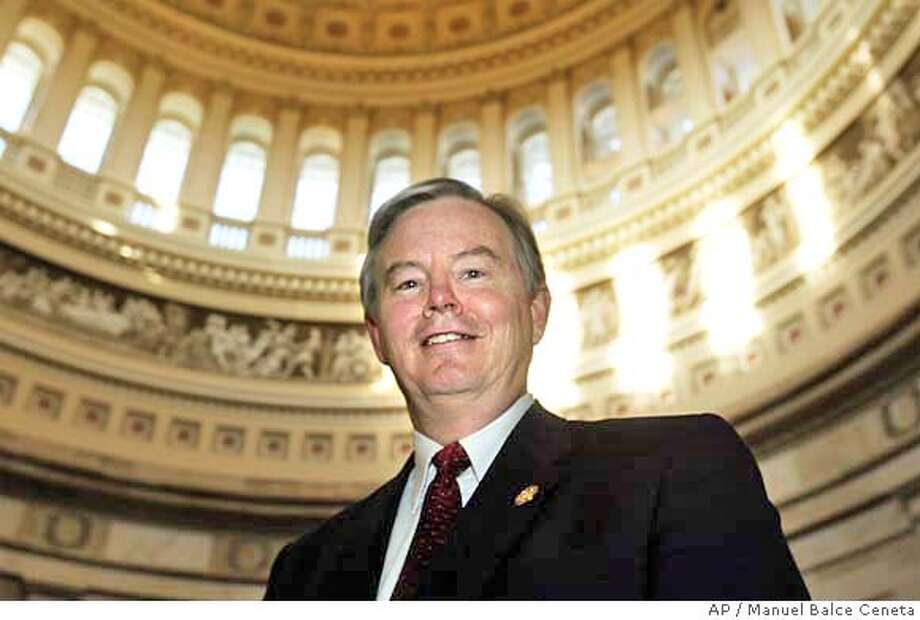Rep. Joe Barton, R-Texas, poses at the Capitol Rotunda following a House Republican Steering Committee meeting on the Capitol Hill, Wednesday, Feb. 11, 2004, in Washington. Barton was nominated by the Steering Committee to be the new chairman of the Committee on Energy and Commerce which will be confirmed when the House goes back into session the last week of February. (AP Photo/Manuel Balce Ceneta) Rep. Joe Barton, R-Texas, is chairman of the House Energy and Commerce Committee. Rep. Joe Barton, R-Texas, is chairman of the House Energy and Commerce Committee. Ran on: 07-18-2004 Ran on: 07-18-2004 Nation#MainNews#Chronicle#7/18/2004#ALL#5star##0421615886 Photo: MANUEL BALCE CENETA