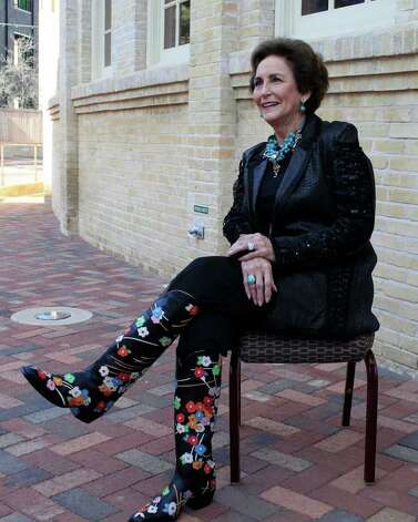 Honoree Olive Anne Kleberg shows-off her fancy boots for the benefit of photographers at the San Antonio Stock Show & Rodeo 7th Annual Cowgirls Live Forever luncheon and fashion show, honoring Olive Anne Kleberg Thursday, January 19, 2012 at the Pearl Stable in San Antonio. Fashions are provided by Julian Gold. Photo: J. MICHAEL SHORT, SPECIAL TO THE EXPRESS-NEWS / THE SAN ANTONIO EXPRESS-NEWS