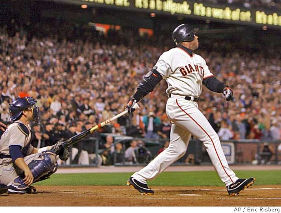 San Francisco Giants' Barry Bonds follows his 700th career home run off San Diego Padres' pitcher John Peavy during the third inning of their game in San Francisco Friday Sept. 17, 2004. At left is Padres' catcher Ramon Hernandez.(AP Photo/Eric Risberg) Photo: ERIC RISBERG