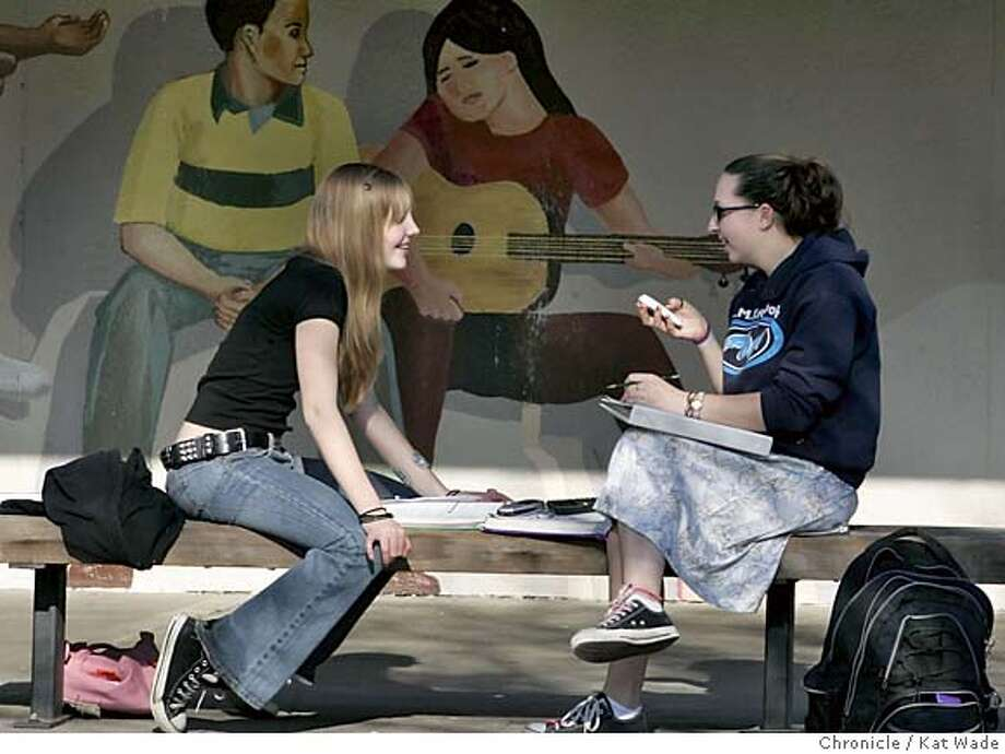 SCHOOLTAX_012_KW.jpg  On 3/9/05 in Lafayette Acalanes High School freshmen, (L to R) chorus member Ursula Heaton, 14 and Band member Lelah Smick, 14, who plays flute, sit in the high school courtyard working on their algebra homework after school Wednesday afternoon. Yesterday's vote on the parcel tax should benefit the music programs at Acalanes High School.  Kat Wade/ The Chronicle MANDATORY CREDIT FOR PHOTOG AND SF CHRONICLE/ -MAGS OUT Photo: Kat Wade