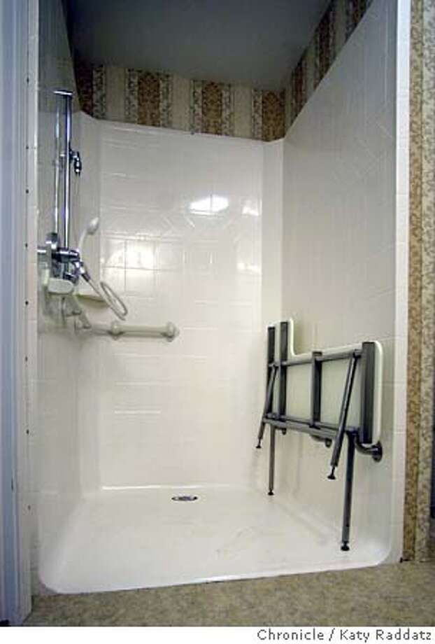 ASSIST10a-C-31JAN02-RE-RAD  Photo by Katy Raddatz--The Chronicle  Assisted living center, called Belmont Village, in San Jose (500 So. Winchester Bl.), is rental units that offer assisted living for those who need it. SHOWN: shower in a unit showing facitities for older/disabled tenant. Includes large seat/shelf, hand-held or attatched shower head, and low threshhold for those in walkers or wheelchairs, as well as grab bars and big shower space. CAT Photo: KATY RADDATZ