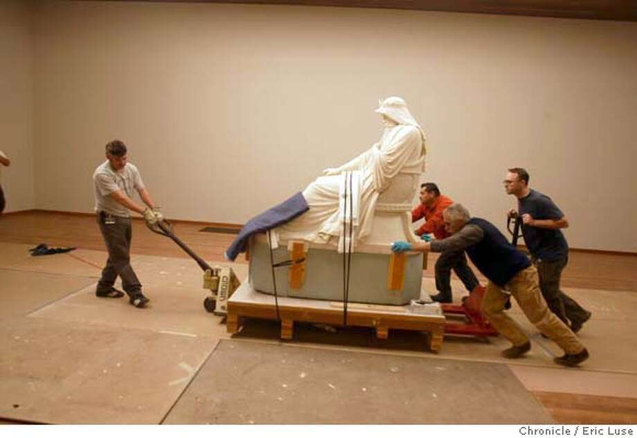 deyoung11_0117_el.jpg  Estenban Granados, Casey Logan (far) Pete Herrera,(middle) and Gregory Wescott (near rear) all art installers from Atthow Fine Art Services taking King Saul to his new home at the De Young.  We shoot the first piece of art entering its new home at the new DeYoung Museum. It's a 5,000 pound marble sculpture of King Saul. While we're there also shoot updated photos of the new museum which opens in October and also the environs of the museum for future stories. 3/10/05 in San Francisco. Eric Luse / The Chronicle MANDATORY CREDIT FOR PHOTOG AND SF CHRONICLE/ -MAGS OUT Photo: Eric Luse
