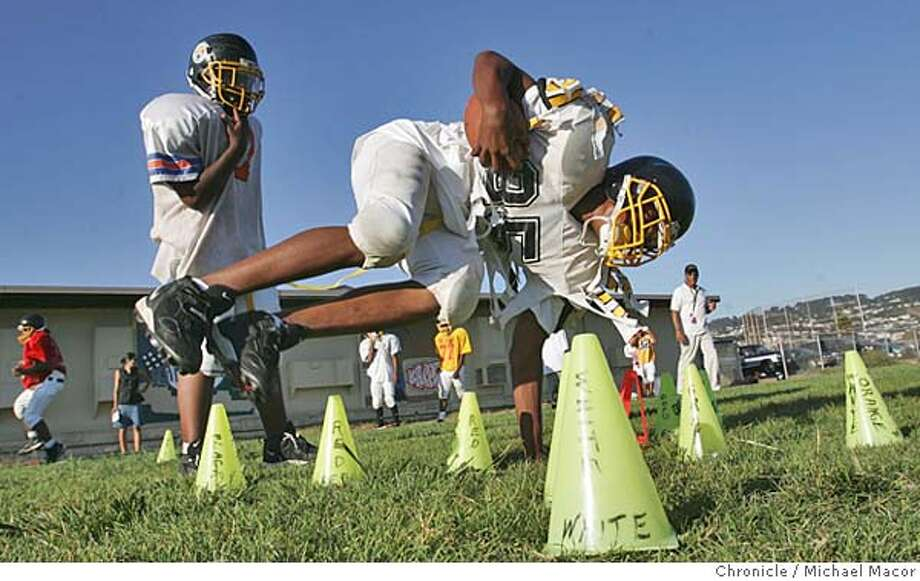 Robert Edmondson stays low as he goes through some running drills. Richmond Steelers, Midget youth football club. Richmond's rough and tumble Iron Triangle neighborhood is home to one of the best youth football teams in the Bay Area. on 9/7/04. Michael Macor / San Francisco Chronicle Photo: Michael Macor